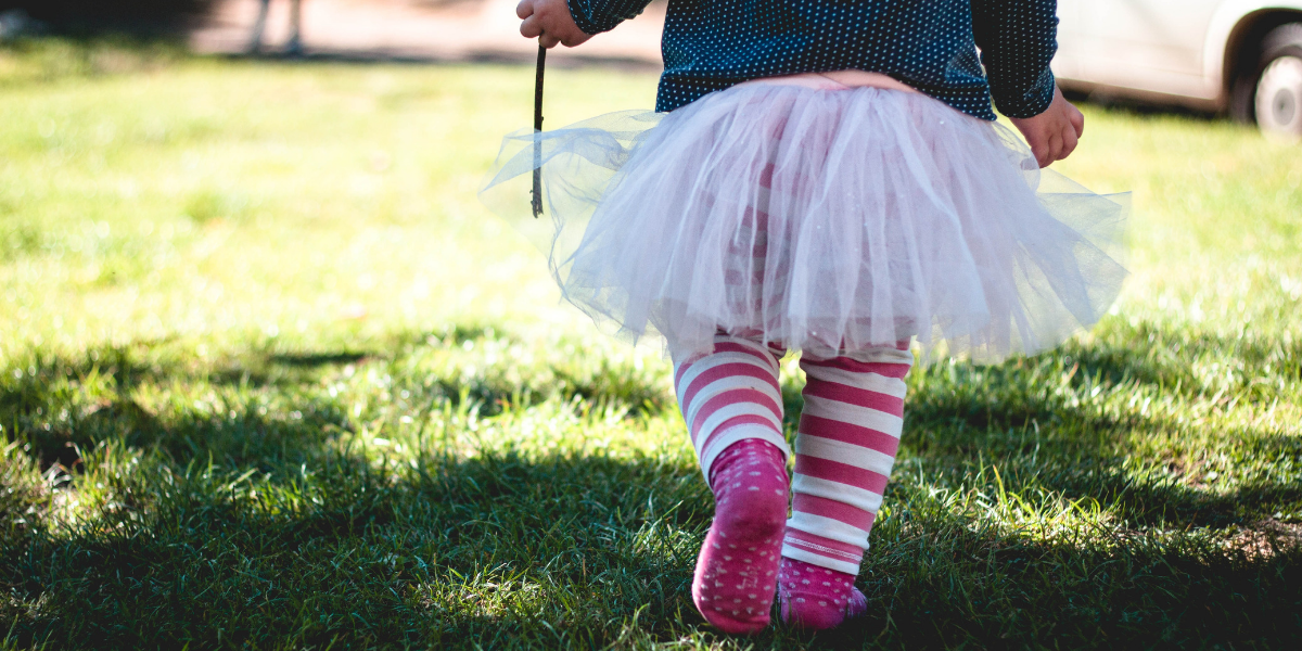Image of little girl in tutu on grass