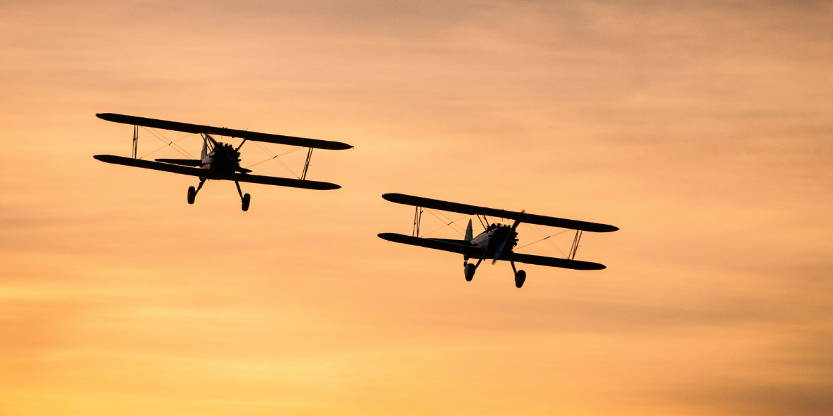 Image of airplanes in an evening sky